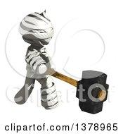 Clipart Of A Fully Bandaged Injury Victim Or Mummy Swinging A Sledgehammer Royalty Free Illustration