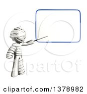 Clipart Of A Fully Bandaged Injury Victim Or Mummy Pointing To A White Board Royalty Free Illustration