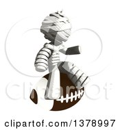 Clipart Of A Fully Bandaged Injury Victim Or Mummy Sitting On A Football Royalty Free Illustration