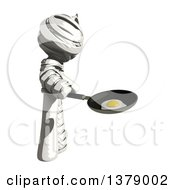 Clipart Of A Fully Bandaged Injury Victim Or Mummy Frying An Egg Royalty Free Illustration by Leo Blanchette