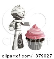 Clipart Of A Fully Bandaged Injury Victim Or Mummy With A Cupcake Royalty Free Illustration by Leo Blanchette