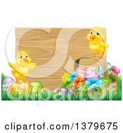 Clipart Of Cute Yellow Chicks On Easter Eggs And A Basket In The Grass Over A Blank Wood Sign Royalty Free Vector Illustration