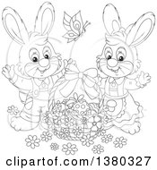 Clipart Of A Black And White Easter Bunny Rabbit Couple With A Basket Of Eggs Royalty Free Vector Illustration
