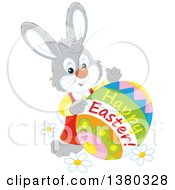 Clipart Of A Gray Bunny Rabbit With A Decorated Happy Easter Egg Royalty Free Vector Illustration