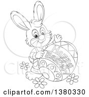 Clipart Of A Black And White Bunny With A Decorated Happy Easter Egg Royalty Free Vector Illustration