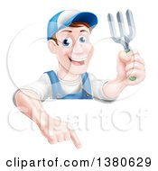 Clipart Of A Middle Aged Brunette White Male Gardener In Blue Holding A Garden Fork And Pointing Down Over A Sign Royalty Free Vector Illustration