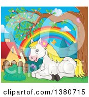 Clipart Of A Cute White And Blond Pony Resting Near Homes And A Rainbow In The Spring Royalty Free Vector Illustration