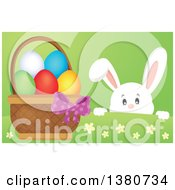 Clipart Of A White Bunny Rabbit Peeking Over A Hill At An Easter Basket Full Of Eggs Royalty Free Vector Illustration