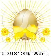 Clipart Of A 3d Golden Easter Egg With A Yellow Bow Flowers And Burst Royalty Free Vector Illustration