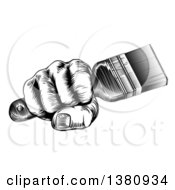 Clipart Of A Retro Black And White Woodcut Fisted Hand Holding A Paintbrush Royalty Free Vector Illustration