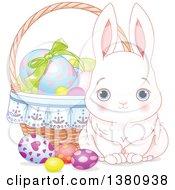 Cute White Easter Bunny By A Basket Of Decorated Eggs