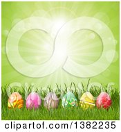 Clipart Of A Row Of 3d Easter Eggs In Grass Against A Green Sunburst Royalty Free Vector Illustration by KJ Pargeter