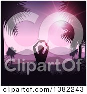 Clipart Of A Relaxed Silhouetted Woman Doing Yoga Between Palm Trees Against A Tropical Mountainous Sunset Royalty Free Vector Illustration