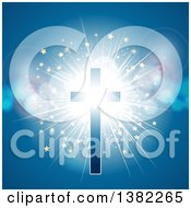 Clipart Of A Glowing Cross With A Starry Light Burst And Flares On Blue Royalty Free Vector Illustration by elaineitalia