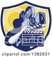 Clipart Of A Retro Male Cameraman Filming And Holding A Clapper In A Blue White And Yellow Shield Royalty Free Vector Illustration