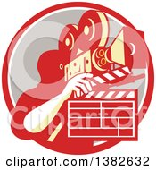 Clipart Of A Retro Male Cameraman Filming And Holding A Clapper In A Red White And Taupe Circle Royalty Free Vector Illustration