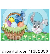 Clipart Of A Happy Gray Easter Bunny Rabbit Peeking Over A Hill At A Basket Of Eggs Royalty Free Vector Illustration