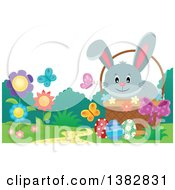 Clipart Of A Happy Gray Easter Bunny Rabbit In A Basket Of Eggs With Spring Flowers And Butterflies Royalty Free Vector Illustration
