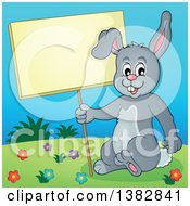 Happy Gray Bunny Rabbit Holding A Blank Sign On A Hill