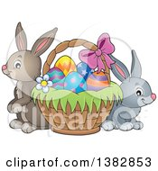 Clipart Of Happy Easter Bunny Rabbits By A Basket Of Eggs Royalty Free Vector Illustration