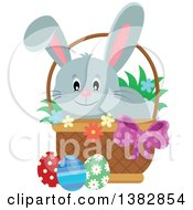 Happy Gray Easter Bunny Rabbit In A Basket Of Eggs