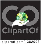 Clipart Of A White Hand Holding A Globe Of Green Leaves On Black Royalty Free Vector Illustration