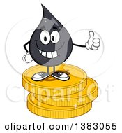 Clipart Of A Cartoon Oil Drop Mascot Giving A Thumb Up And Standing On Coins Royalty Free Vector Illustration