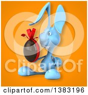Clipart Of A 3d Blue Bunny Rabbit Holding A Chocolate Easter Egg On An Orange Background Royalty Free Illustration