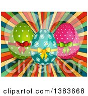 Decorated Easter Eggs With Bows Over Colorful Grungy Rays