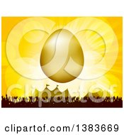 3d Gold Easter Egg Over A Silhouetted Crowd At An Event