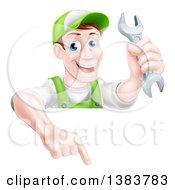 Clipart Of A Happy Middle Aged Brunette Caucasian Mechanic Man In Green Wearing A Baseball Cap Holding A Wrench And Pointing Down Over A Sign Royalty Free Vector Illustration