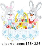 Clipart Of Easter Bunny Rabbits Cheering At A Table With Eggs And A Basket Royalty Free Vector Illustration by Alex Bannykh