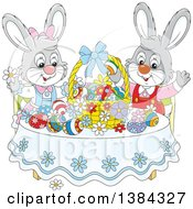 Cartoon Easter Bunny Rabbits Cheering At A Table With Eggs And A Basket