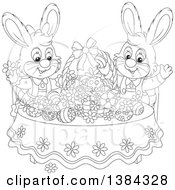 Black And White Lineart Easter Bunny Rabbits Cheering At A Table With Eggs And A Basket