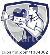 Clipart Of A Profiled Retro Camera Man Filming In A Blue White And Gray Shield Royalty Free Vector Illustration