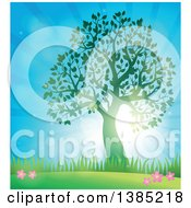 Clipart Of A Green Silhouetted Tree Leafing Out In A Spring Landscape With Sunshine Royalty Free Vector Illustration