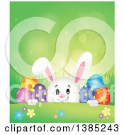 Clipart Of A Bunny Rabbit Peeking Over A Hill With Easter Eggs Flowers And Grass Over Green Flares Royalty Free Vector Illustration
