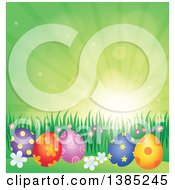 Clipart Of A Background Of Patterned Easter Eggs Grass And Flowers Against A Green Sky With Sunshine Royalty Free Vector Illustration