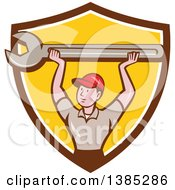 Poster, Art Print Of Retro Cartoon White Male Mechanic Holding Up A Giant Spanner Wrench In A Brown White And Yellow Shield