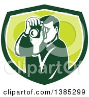Clipart Of A Retro Male Photographer Taking Pictures In A Green And White Shield Royalty Free Vector Illustration