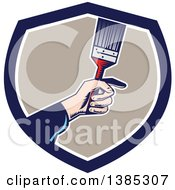 Clipart Of A Retro Woodcut Caucasian Painters Hand Holding A Paintbrush In A Blue White And Taupe Shield Royalty Free Vector Illustration