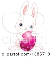 Cute White Easter Bunny Rabbit Holding An Egg With Hearts