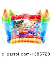 Clipart Of Cartoon Happy White And Black Girls Jumping On A Bouncy House Castle Royalty Free Vector Illustration