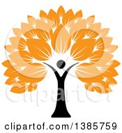 Black Silhouetted Person Forming The Trunk Of A Tree With Orange Leaves