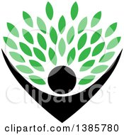 Clipart Of A Black Silhouetted Person Holding Up Green Leaves Royalty Free Vector Illustration
