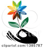 Clipart Of A Black Silhouetted Hand Holding A Colorful Flower Royalty Free Vector Illustration by ColorMagic