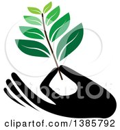Clipart Of A Black Silhouetted Hand Holding A Branch With Green Leaves Royalty Free Vector Illustration