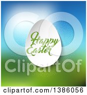 Happy Easter Greeting On A 3d Paper Egg Over Blurred Grass And Sky
