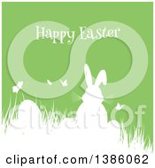 Clipart Of A White Silhouetted Bunny Rabbit With Butterflies And Eggs In Grass Over Green Royalty Free Vector Illustration by KJ Pargeter