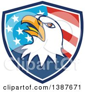 Clipart Of A Cartoon Bald Eagle Head In An American Flag Shield Royalty Free Vector Illustration